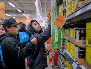 Two teenage Indigenous boys shopping in a supermarket