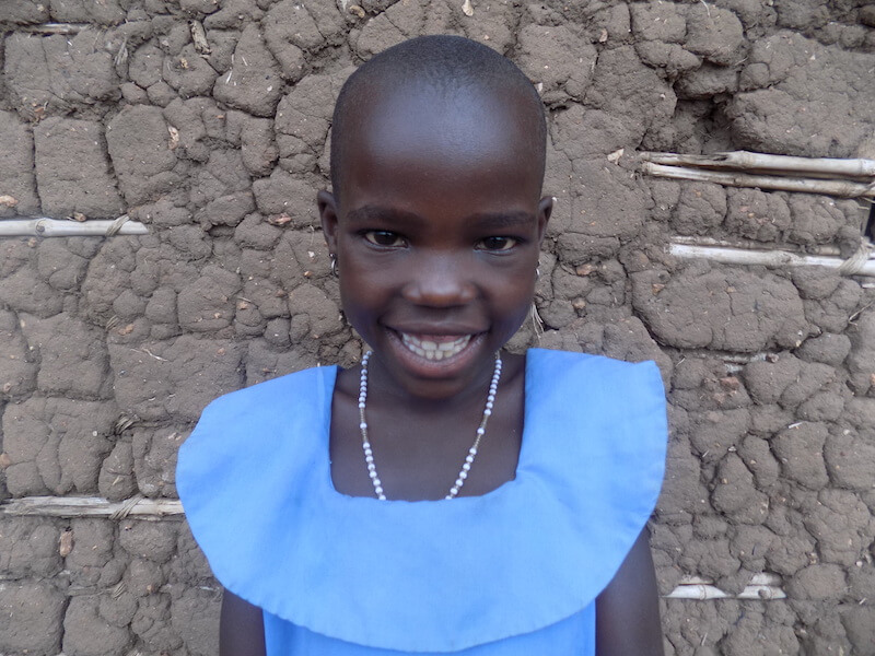 8-year-old Immaculate from Uganda smiles at the camera