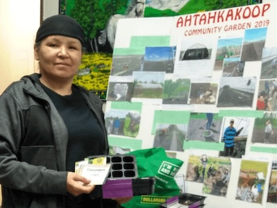 First Nations women shows off garden supplies