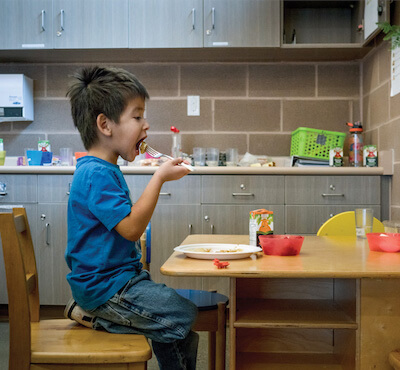 Canadian First Nations child enjoys a healthy meal