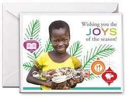Buy a charity gifts as a donation and receive a free Christmas card showing a smiling African girl and Christmas decorations in the background