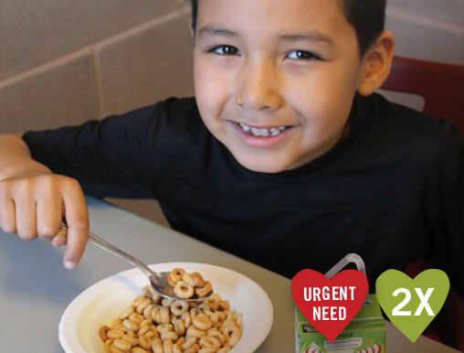 Canadian First Nations boy eats cereal and juice for breakfast