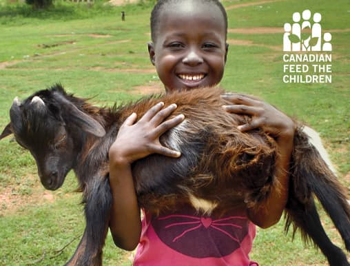 Buy a goat and receive this free card showing a smiling African girl holding a goat