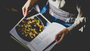 Looking at recipe book   Cannaray CBD