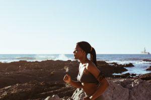 woman running by beach