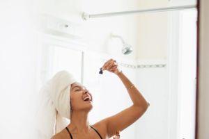 Woman taking CBD Oil | Cannaray CBD