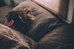 Woman asleep in bed | Cannaray CBD