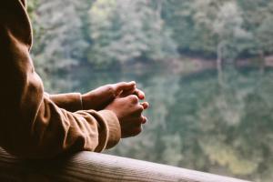 Man hands resting on balcony