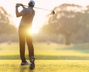 Golfer in morning sunlight