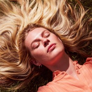 Woman lying in the sun with bright skin