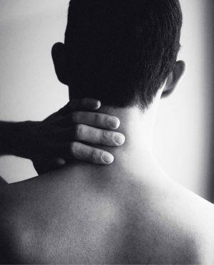 Man massaging neck with Cannaray CBD balm