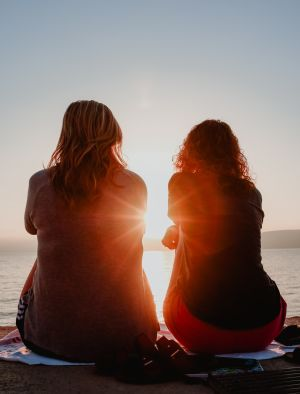 Two ladies watching the sunset