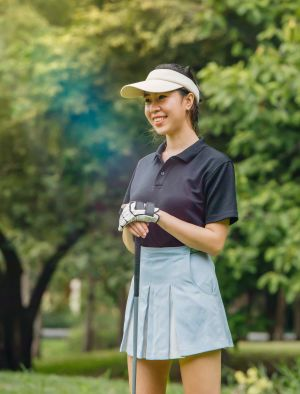Female golfer holding club