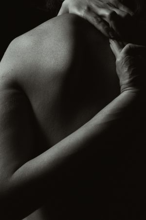 Man shoulder massage with CBD balm