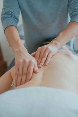 woman massaging back