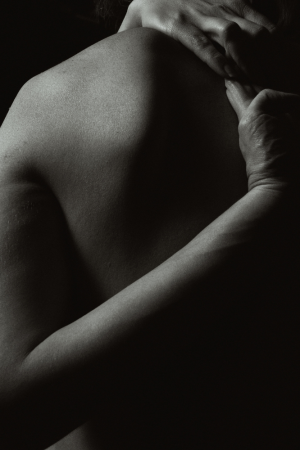 Man massaging neck with CBD balm