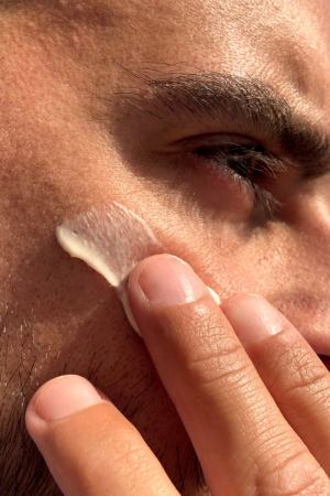 Man applying Cannaray CBD Skin Cream