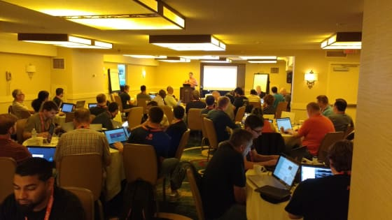 Summit attendees in a session