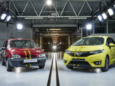 Rover 100 in red and Honda Jazz in yellow