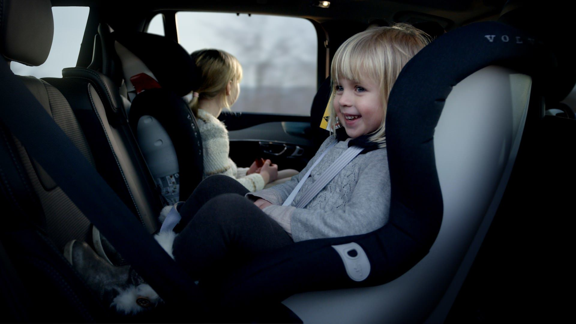 image of a smiling child in a child seat