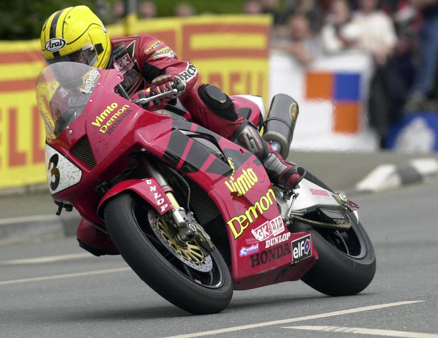 image of joey dunlop riding a honda cbr1000 rr fireblade motorcycle