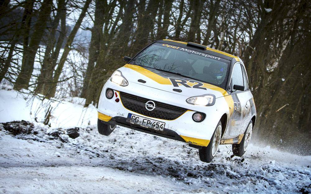 image of an opel rally car on snow