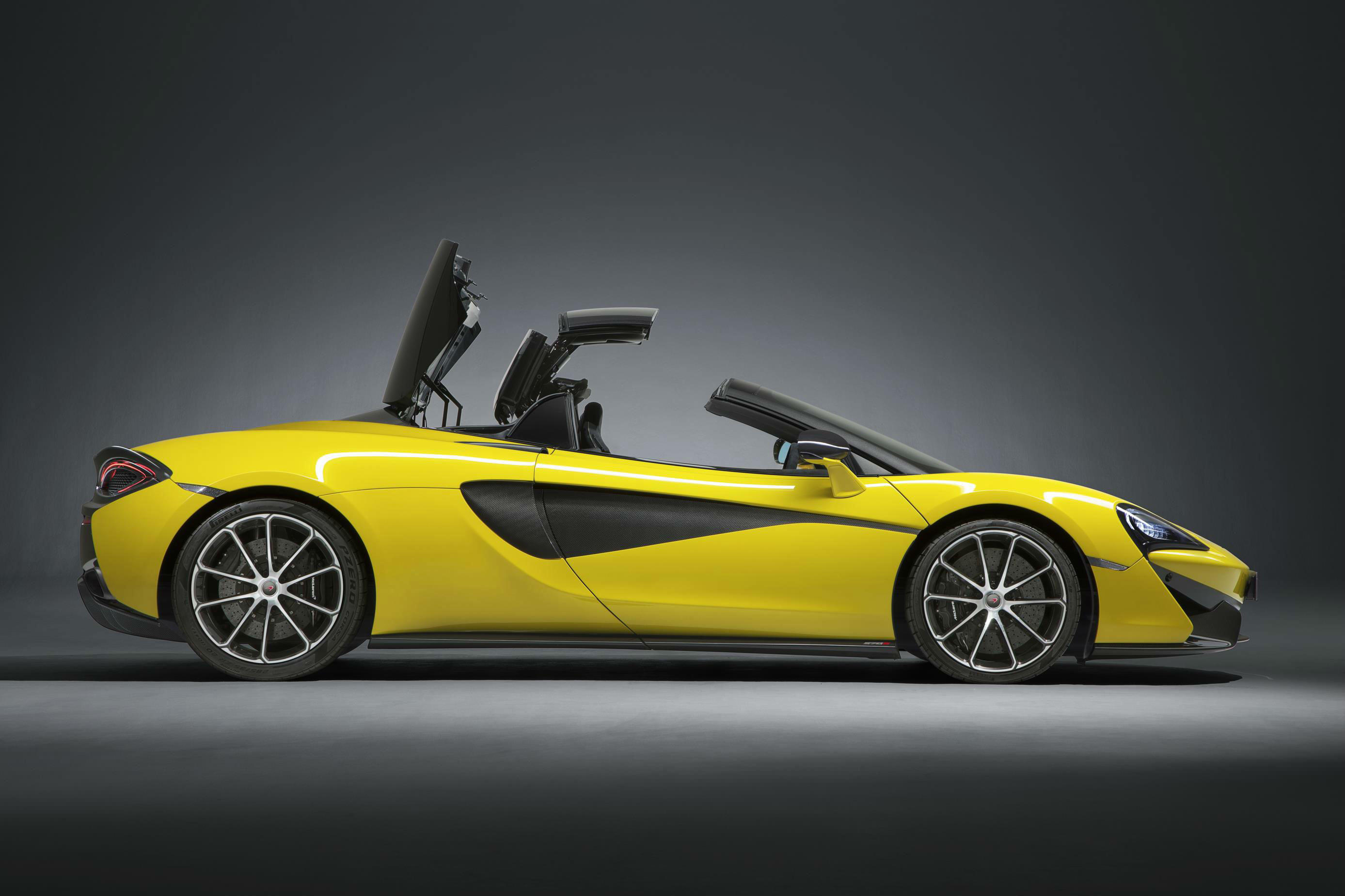 image of a yellow mclaren 570s spider convertible car
