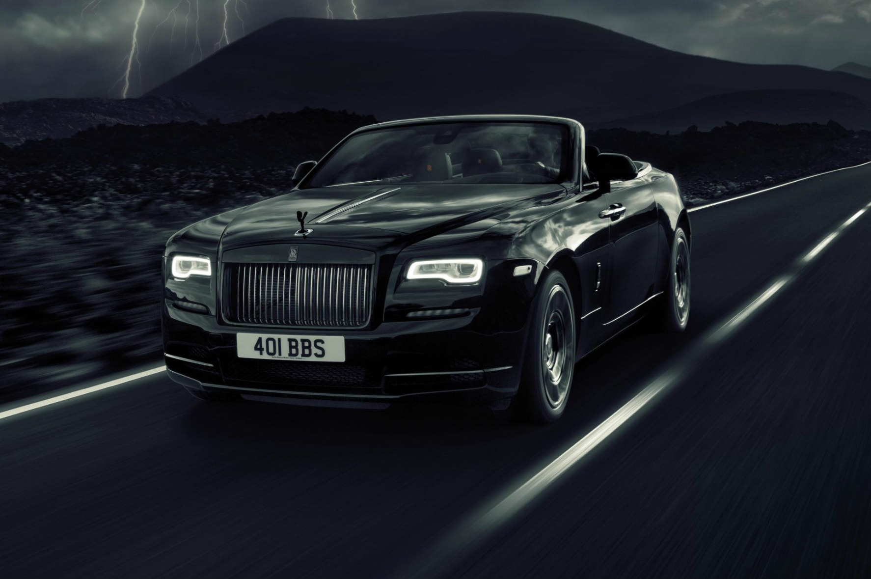 image of a black rolls royce dawn black badge car