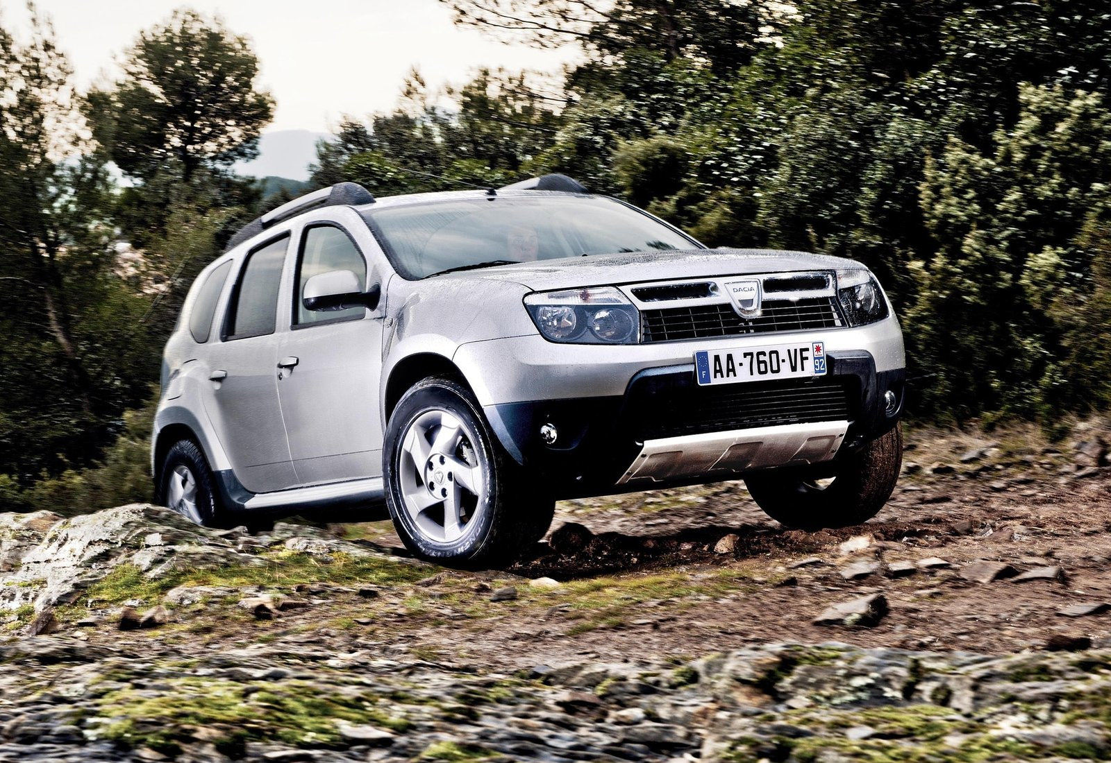 image of silver dacia duster in off road conditions