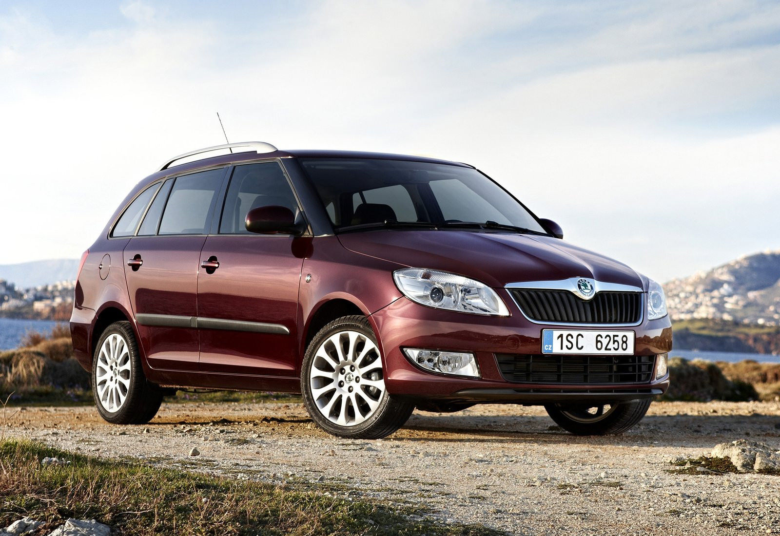image of a maroon skoda fabia estate car exterior