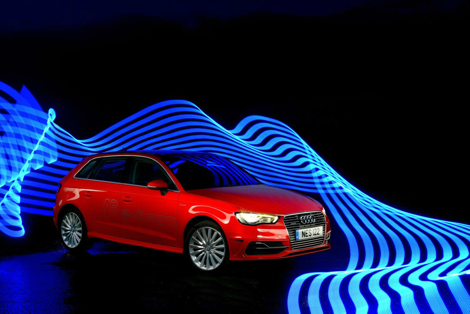 image of a red audi a3 etron plugin hybrid car exterior