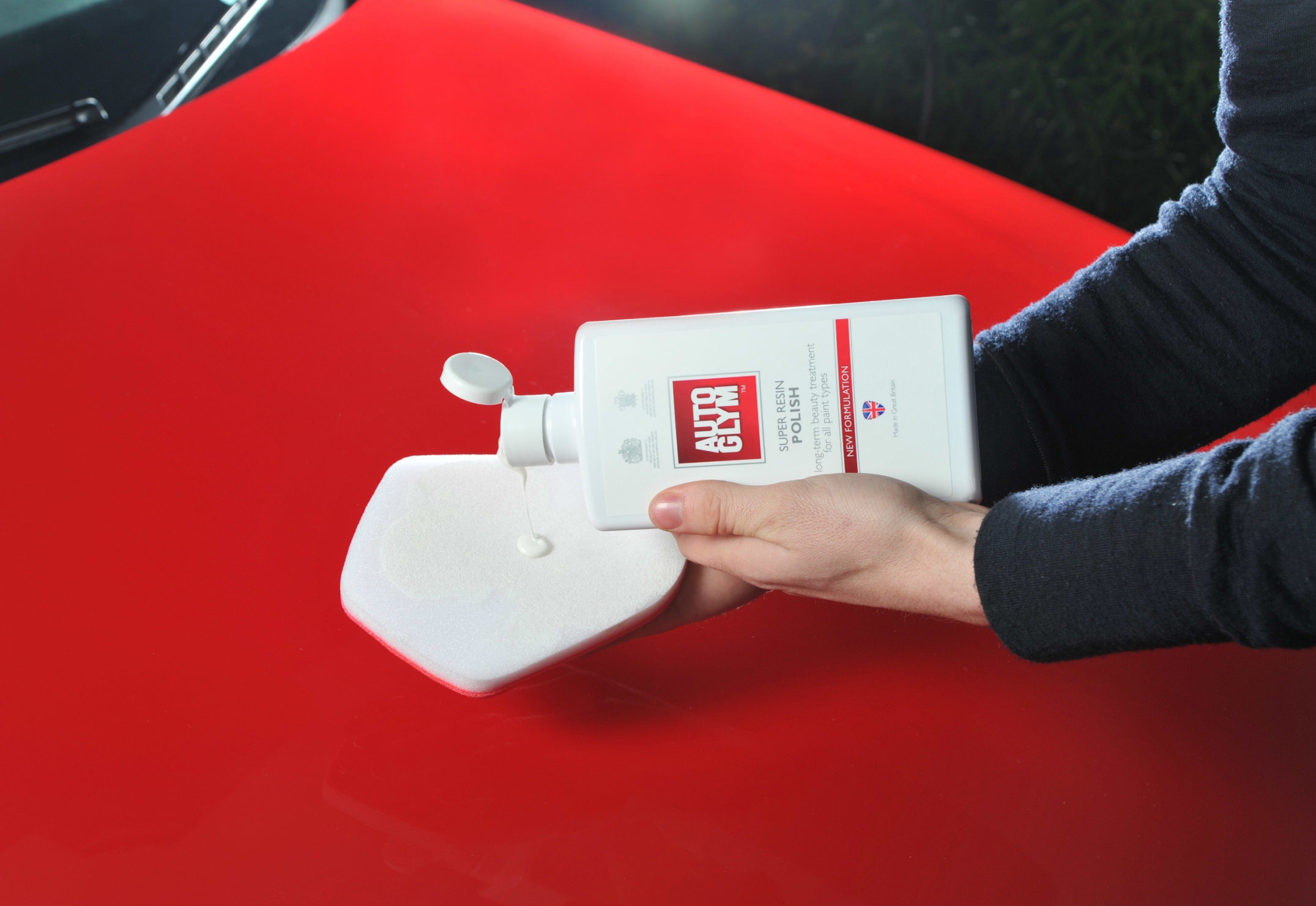 image of auto glym car polish being applied to a car