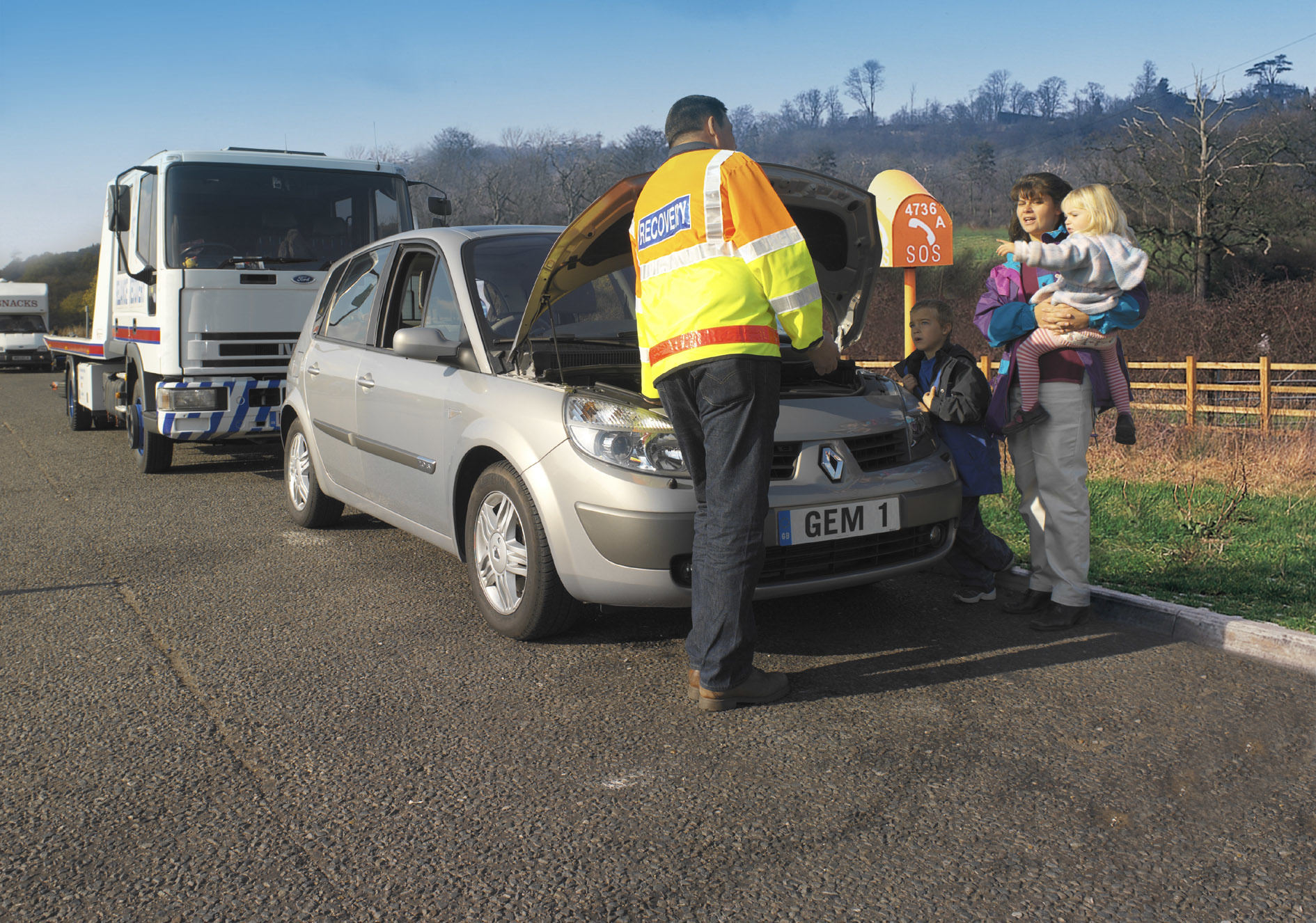 image of a car broken down being attended to by emergency breakdown services