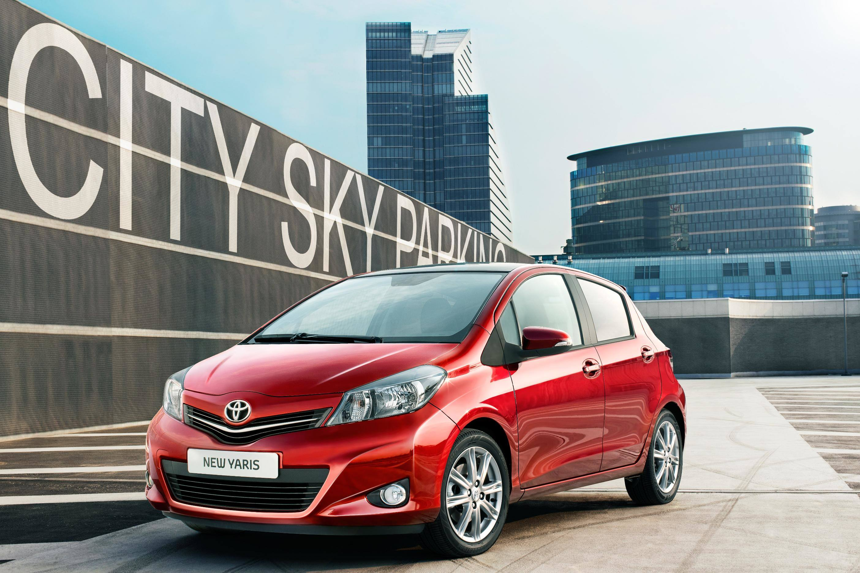 image of a red toyota yaris car exterior