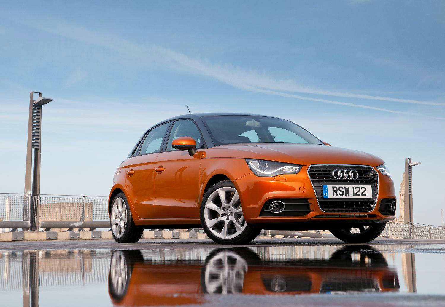 image of a orange audi a1 car exterior