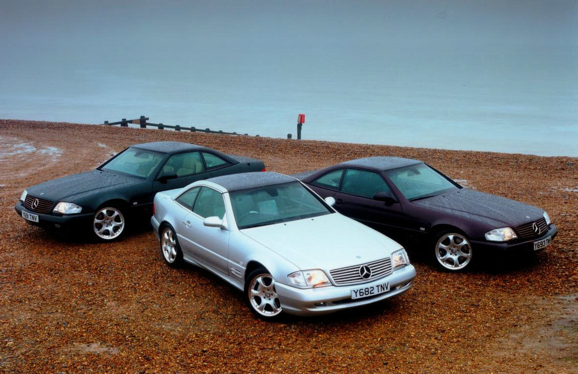 image of three mercedes-benz sl cars on a beach
