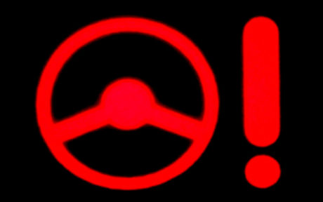 image of red power steering dashboard warning light