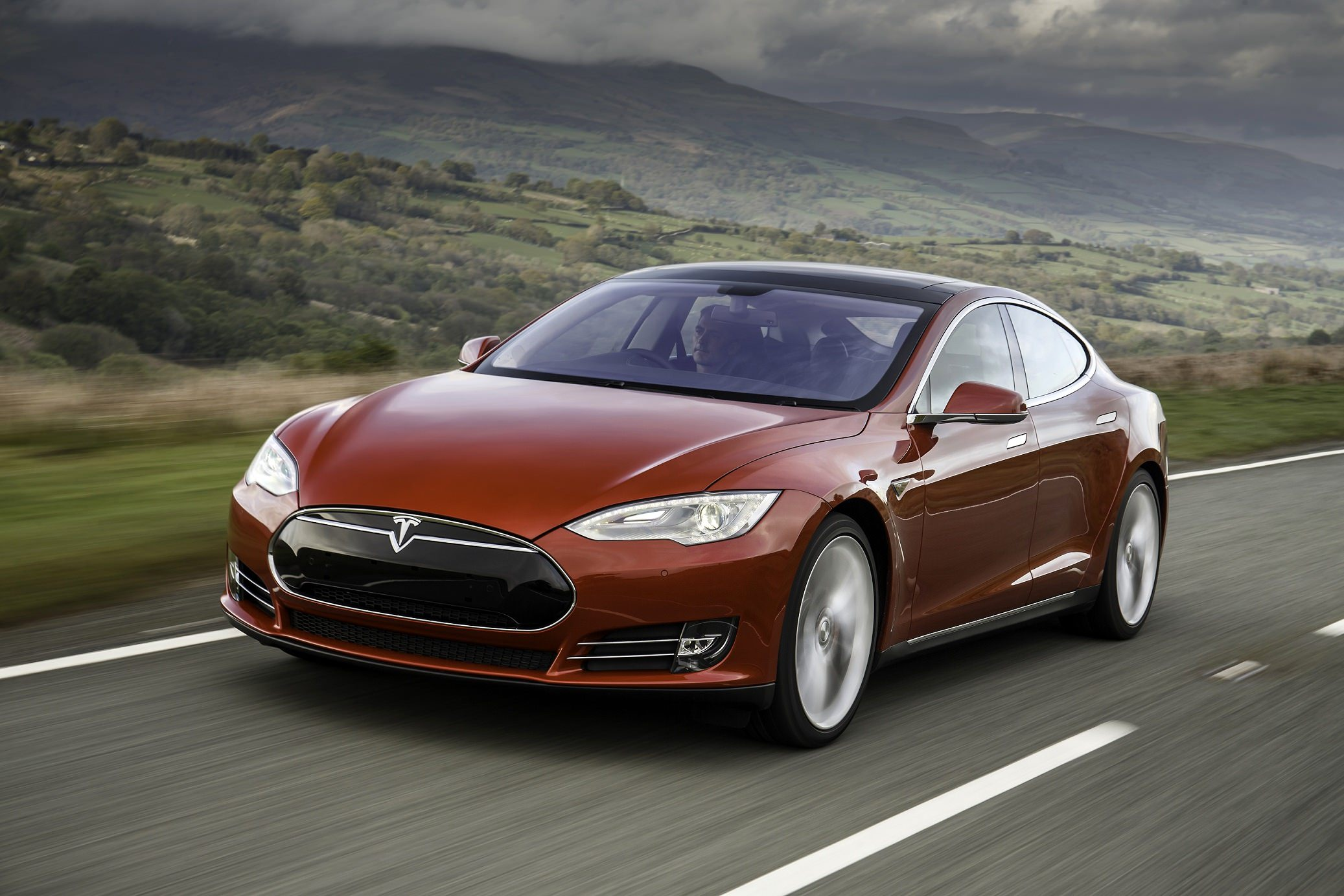 image of a red tesla car exterior