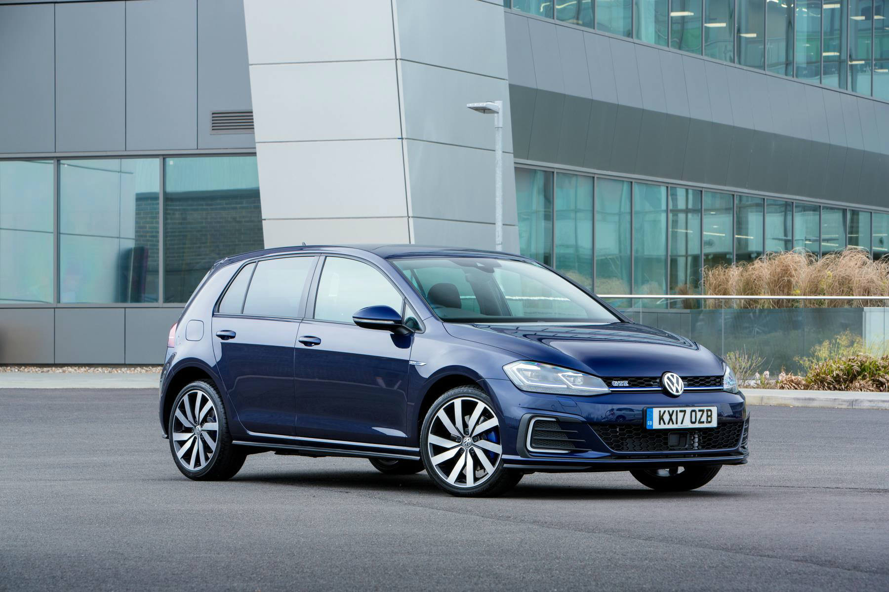 image of a blue volkswagen golf gte car exterior