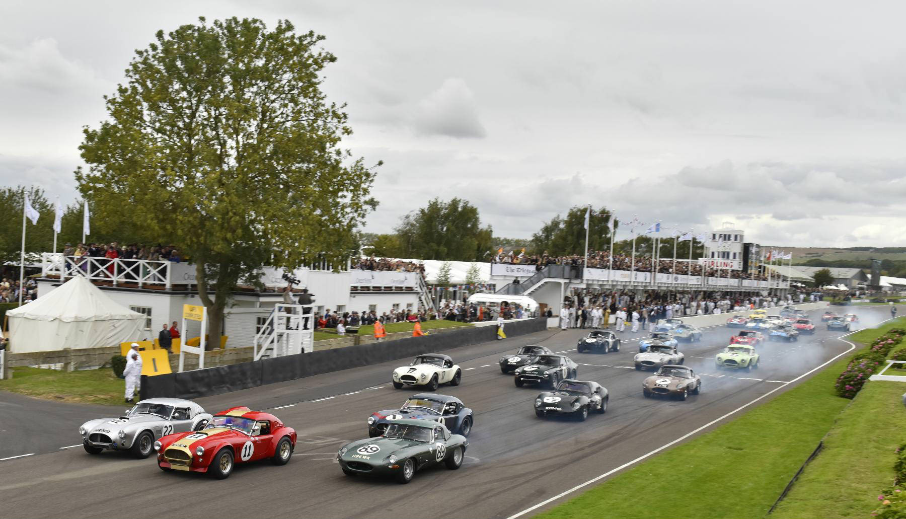 image of vintage cars racing at goodward revival festival 2017