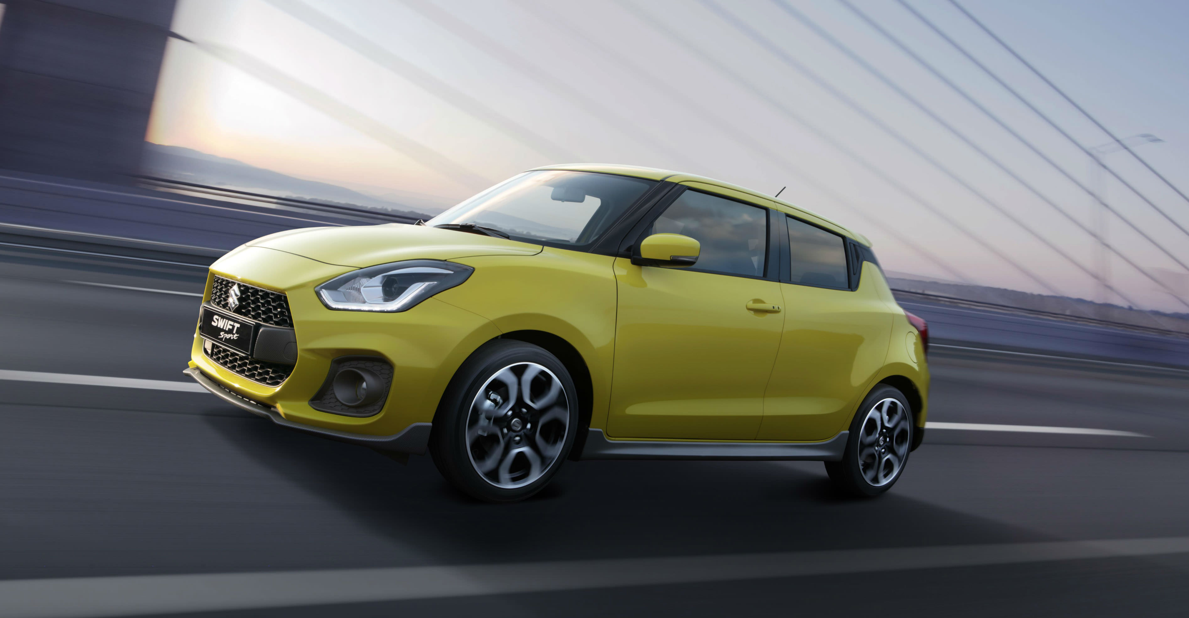 image of a yellow suzuki swift concept car at frankfurt motor show 2017
