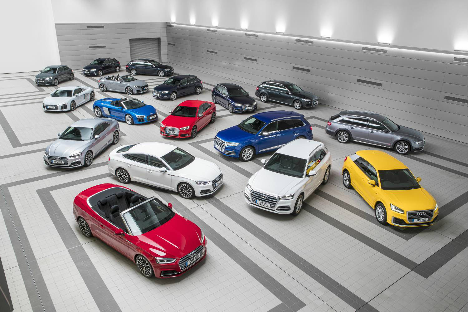 image of a variety of audi cars parked up in a showroom