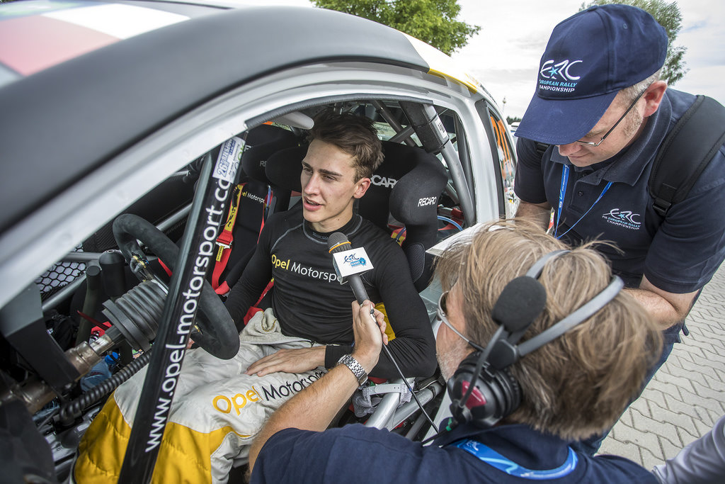image of chris ingram rally driver being interviewed in his rally car