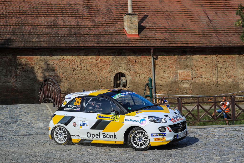 image of chris ingrams rally car racing on cobbled road