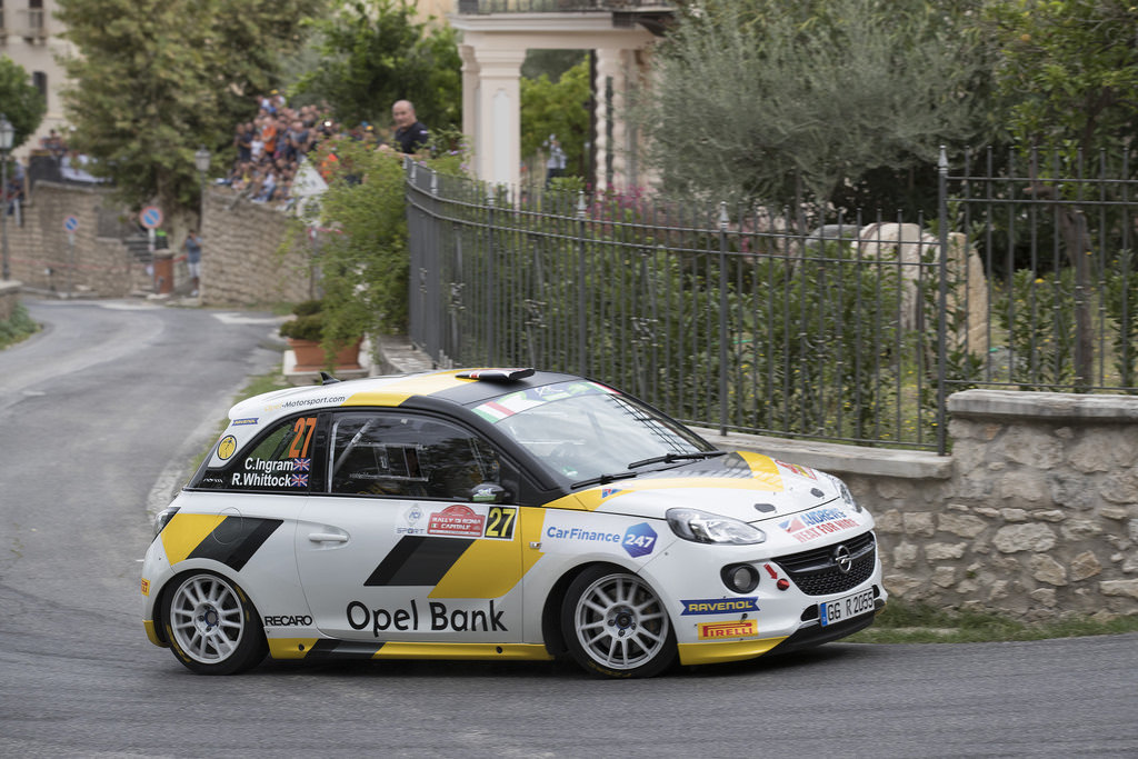 image of chris ingrams rally car racing on street road