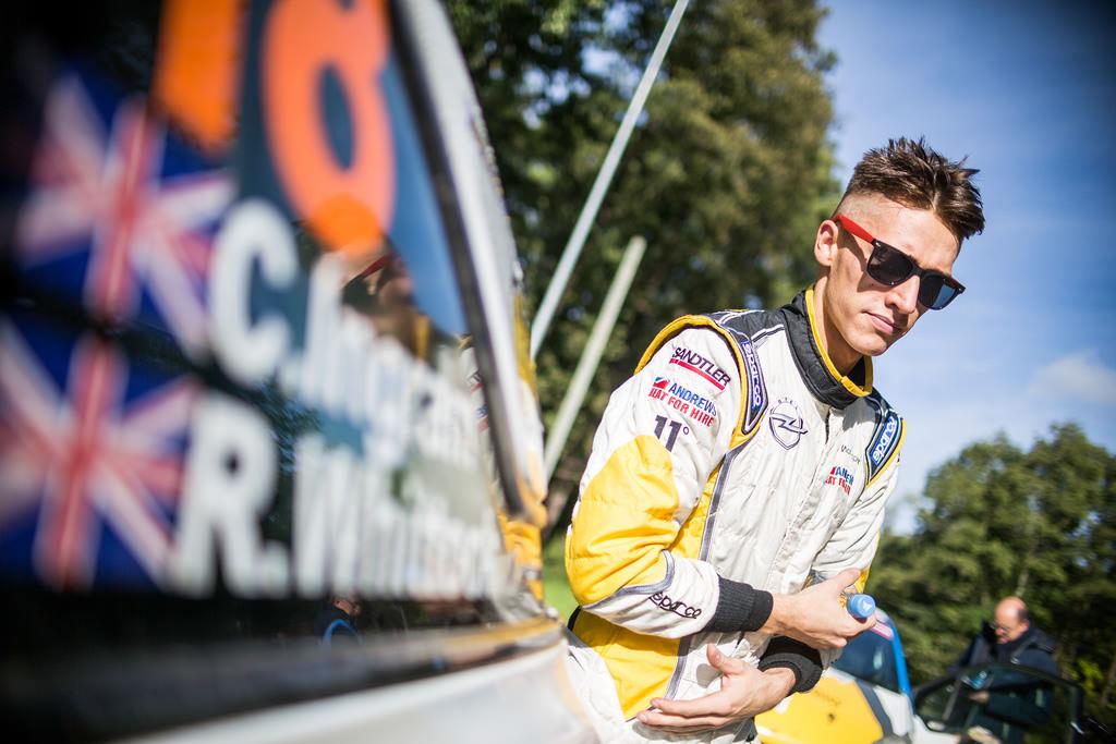 image of chris ingram rally driver next to his car