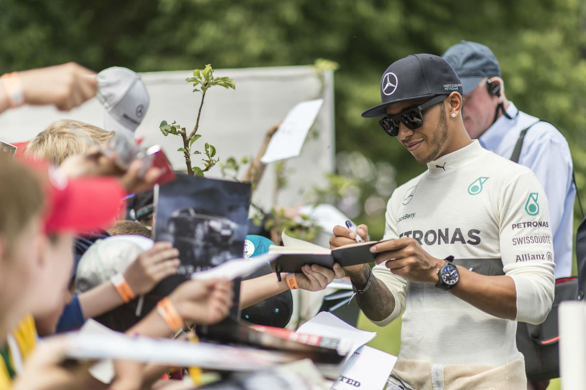 image of lewis hamilton f1 driver signing autographs