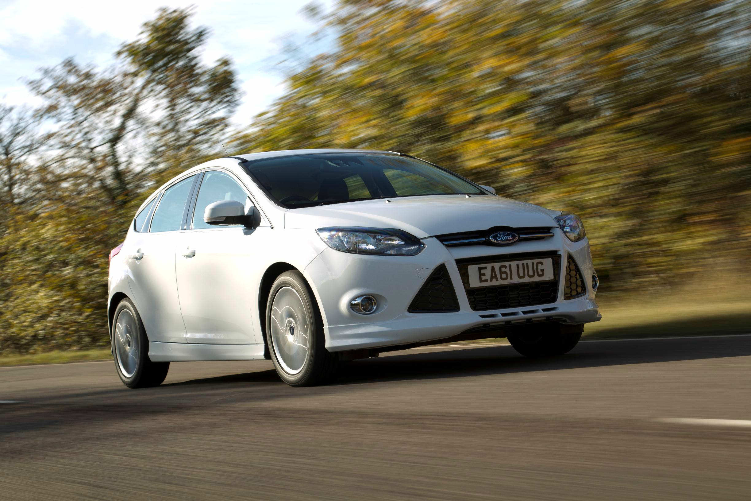 image of a white ford focus car on a country road