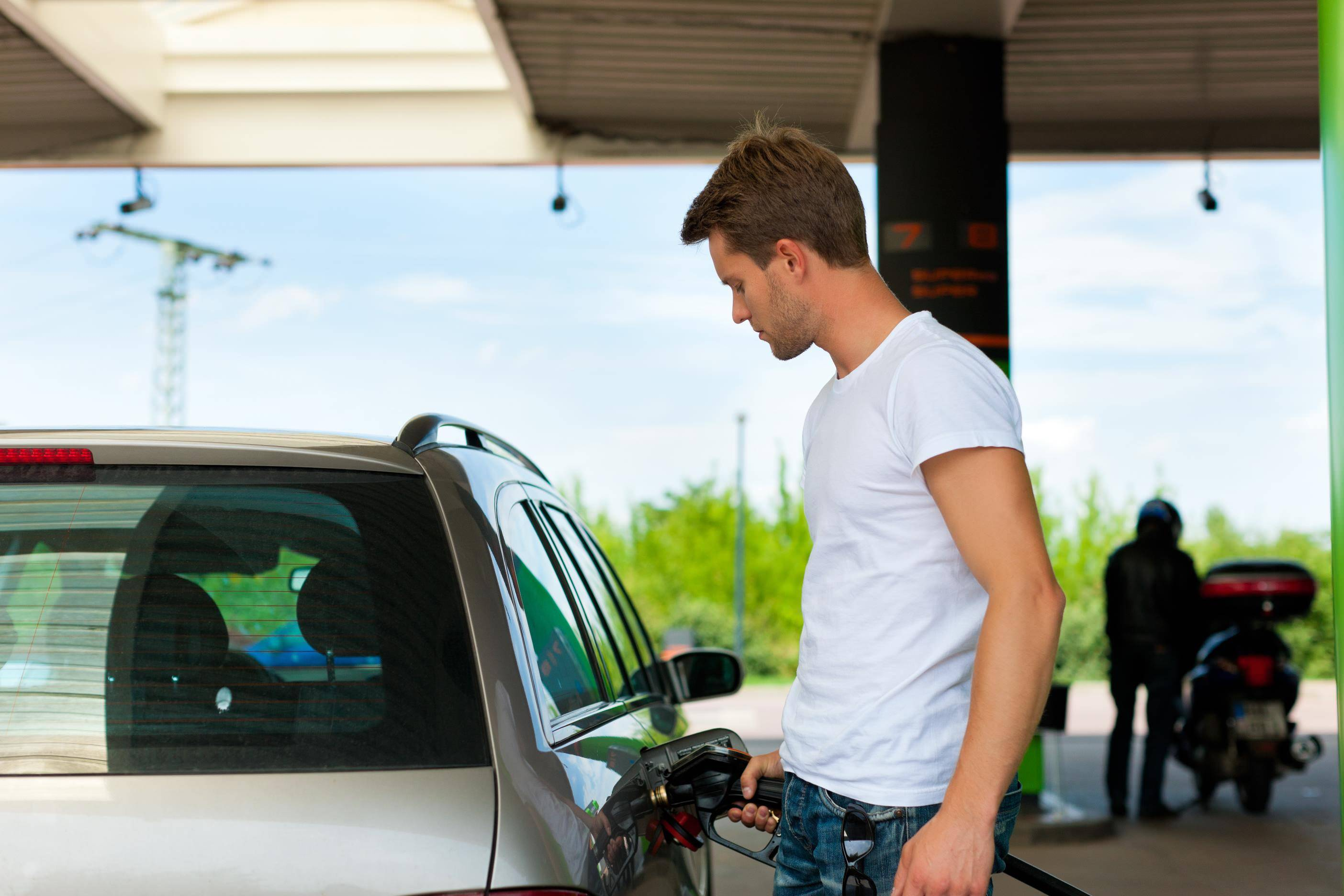 image of a person filling up their car with petrol