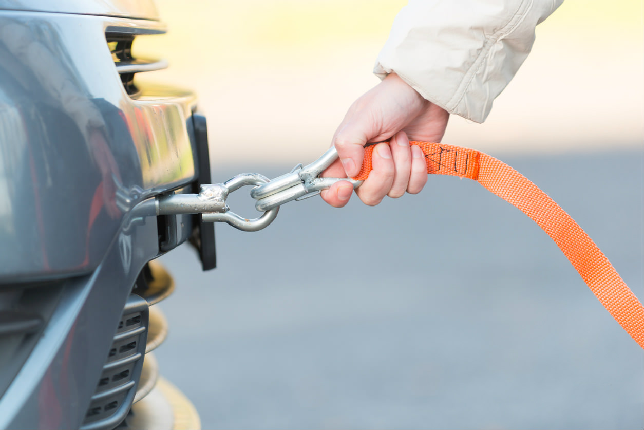 image of a tow rope being attached to a car